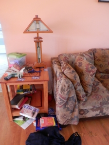 Daniel's side of the couch; count the books LOL