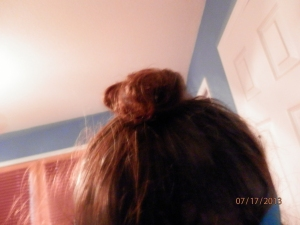I wore my hair up in a bun today; Daniel told me I needed to stick a pencil into the bun